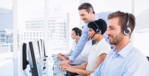 Customer service agents managing calls in a call centre