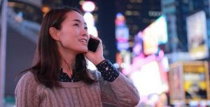Toku ProductivityWoman talking on mobile phone while on the go